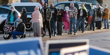 Voters line up outside the HUB to cast their ballots for early voting in the November presidential election Tuesday, Oct. 13, 2020, in downtown Tyler, Texas. (Sarah A. Miller/Tyler Morning Telegraph via AP)