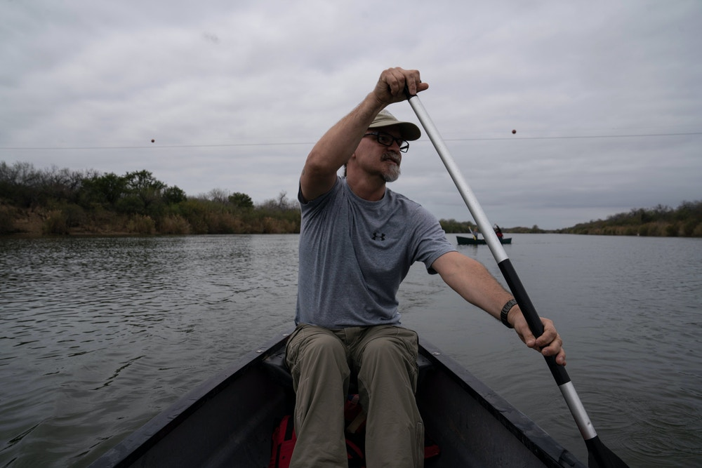 Scott Nicol, an environmentalist, paddles a boat along the Rio Grande in western Starr County on Feb. 15, 2020.Verónica G. Cárdenas for The Intercept