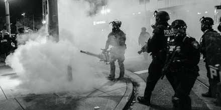 Federal agents deploy tear gas in the neighborhood near the Immigration and Customs Enforcement building in Portland, Ore., on Oct. 17, 2020.