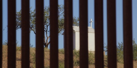 A shrine sits in Mexico near the massive border fence erected by the United States to deter illegal immigration near Sasabe, Arizona, on June 1, 2010.