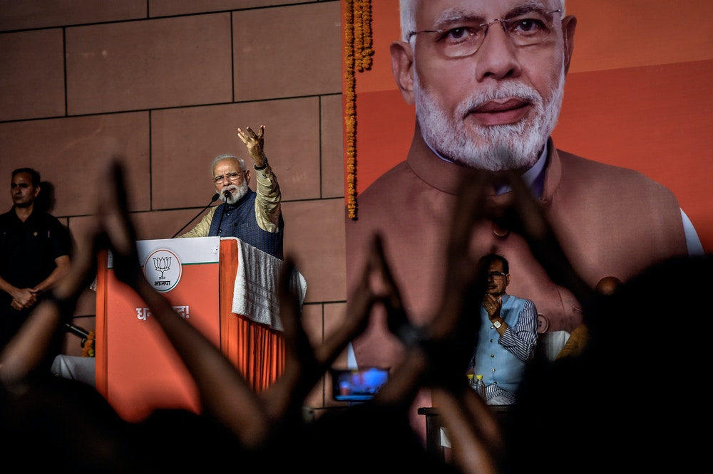 NEW DELHI, INDIA - MAY 23: Narendra Modi speakes to the victorious party workers at the BJP party head quarters in New Delhi, India. Indian Prime Minister Narendra Modis Bharatiya Janata Party (BJP) is set for another five-year term on Thursday after a landslide victory as over 600 million people voted in a marathon seven-phase general elections which lasted over six-weeks. Supporters of the Hindu nationalist party celebrated in the capital New Delhi as Modi is scheduled to appear at the BJP headquarters and leaders across the world congratulated the Indian Prime Minister for his historic return to power for a second straight term. (Photo by Atul Loke/Getty Images)