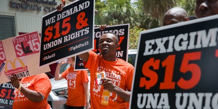 People gather together to ask to raise workers wages to a $15 minimum wage as well as demanding the right to a union on May 23, 2019 in Fort Lauderdale, Florida.