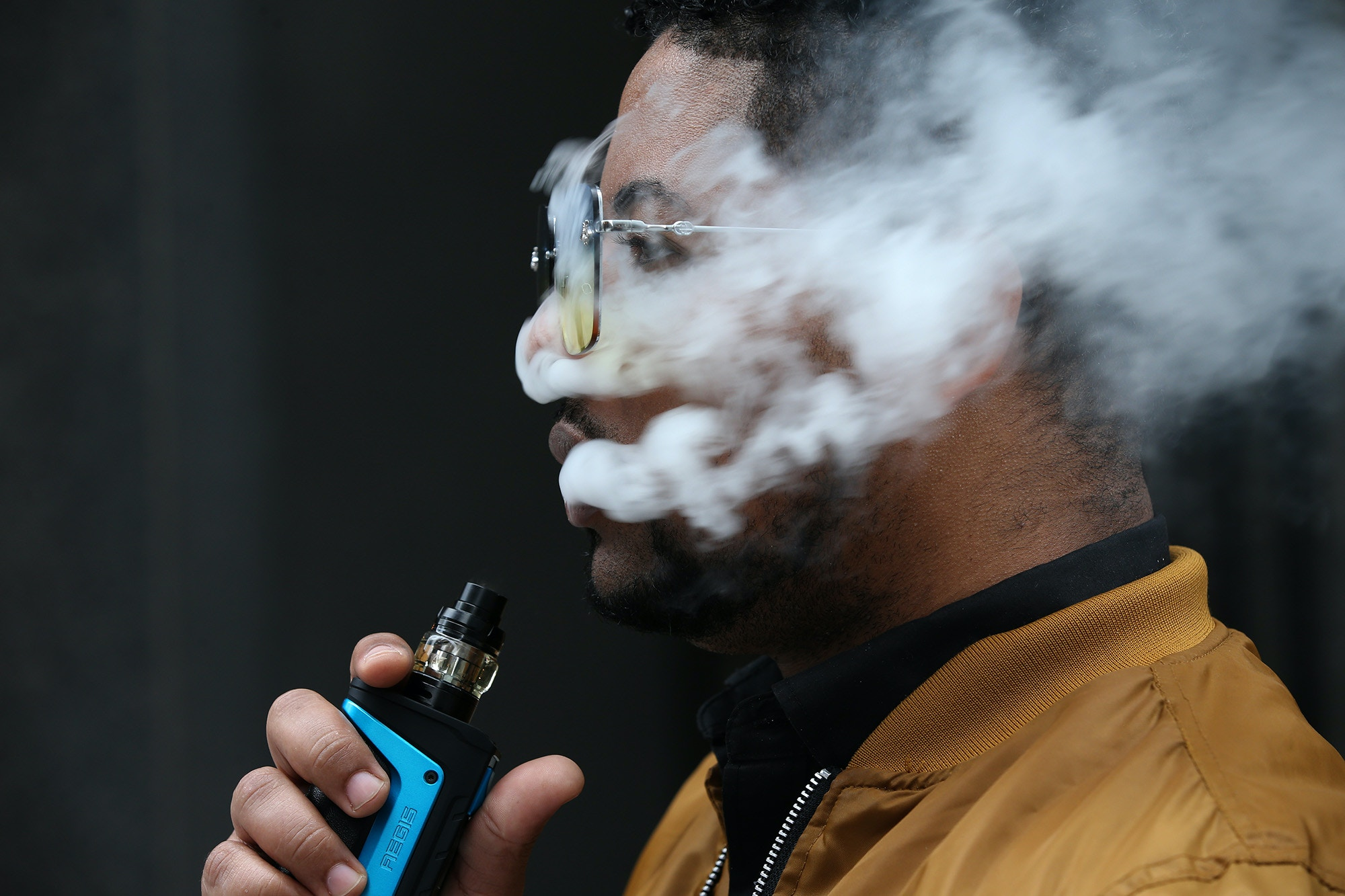 Frankie Paulino, of Chicago, uses his vaping device at Dearborn and Jackson in Chicago, Monday, Sept. 16, 2019. Paulino believes excessive vaping is bad and prefers the mint flavor. (Antonio Perez/Chicago Tribune/Tribune News Service via Getty Images)