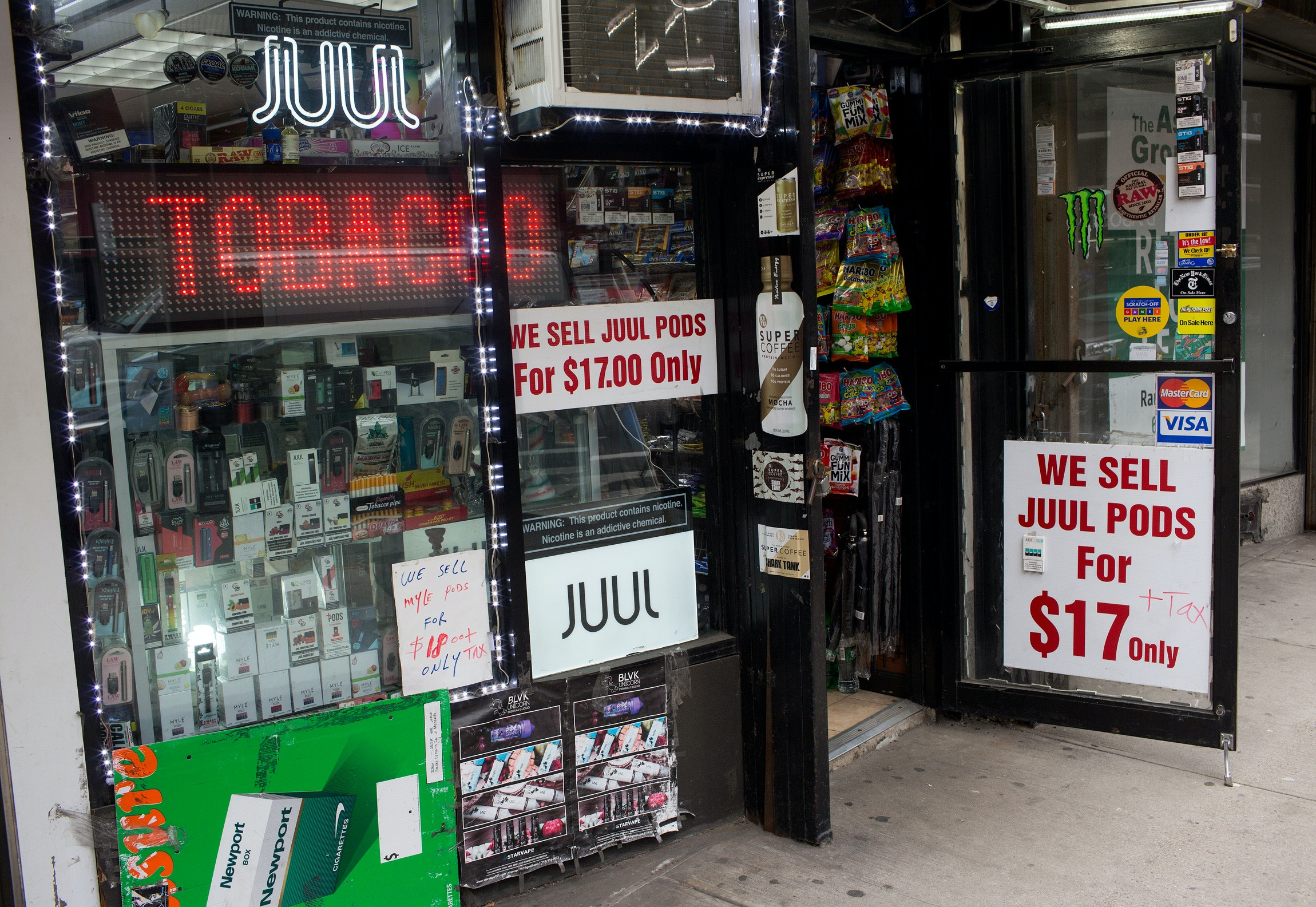 NEW YORK, NEW YORK - JANUARY 27: A tobacco store advertises and sells Juul tobacco products as vaping remains popular despite health warnings, on January 27, 2020 in midtown Manhattan, New York City. (Photo by Andrew Lichtenstein/Corbis via Getty Images)
