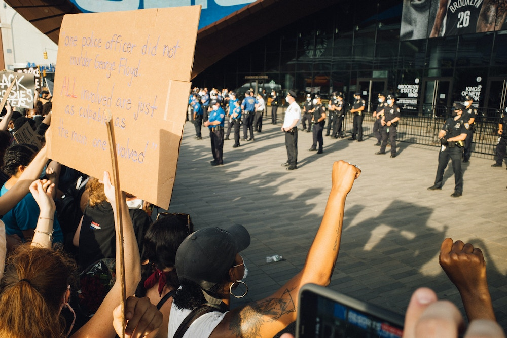 BROOKLYN, NEW YORK, UNITED STATES - May 29, 2020 - Protesters gathered at the Barclay's Center in Brooklyn to protest the death of George Floyd by a Minneapolis police officer.- PHOTOGRAPH BY Joel Sheakoski / Barcroft Studios / Future Publishing (Photo credit should read Joel Sheakoski/Barcroft Media via Getty Images)