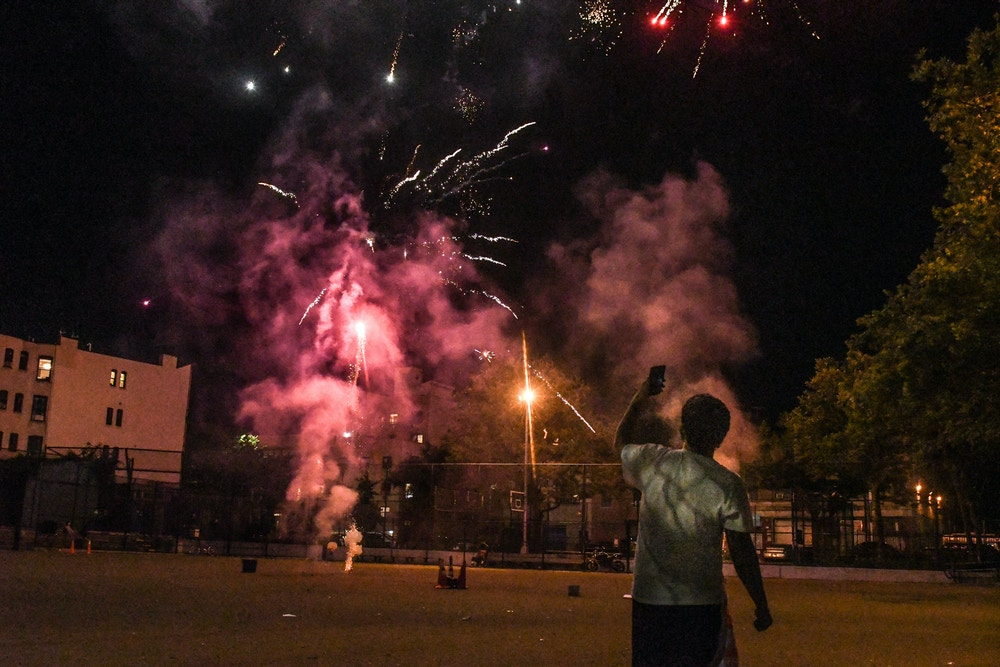 NEW YORK, NY - JUNE 24: A person records with a phone a fireworks display in an empty park on June 24, 2020 in the Brooklyn borough in New York City. According to New York City officials, complaints about fireworks have skyrocketed in recent weeks. (Photo by Stephanie Keith/Getty Images)