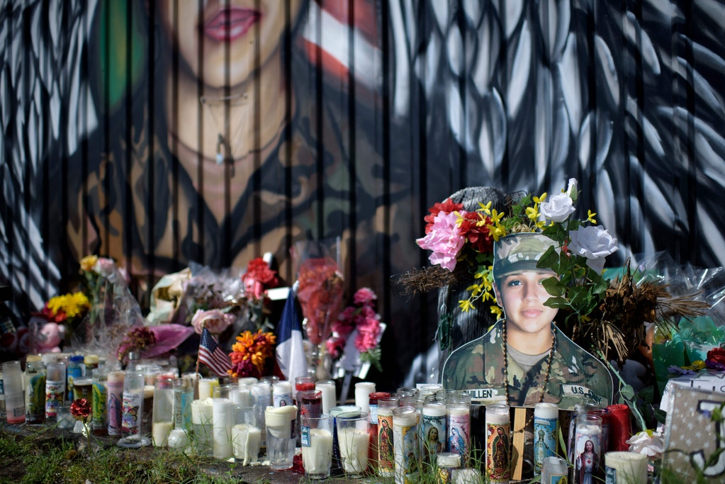 Candles and flowers decorate a makeshift memorial for US Army Specialist Vanessa Guillen at Power House Gym on August 14, 2020, in Houston, Texas.