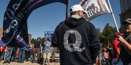 NEW YORK, NY - OCTOBER 03: A person wears a QAnon sweatshirt during a pro-Trump rally on October 3, 2020 in the borough of Staten Island in New York City. The event, which was organized weeks ago, encouraged people to vote Republican and to pray for the health of President Trump who fell ill with Covid-19. (Photo by Stephanie Keith/Getty Images)