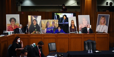 Poster boards of people who may lose their health insurance if the Affordable Care Act is repealed are set up prior to start of the Senate Judiciary Committee confirmation hearing for Supreme Court Justice on Capitol Hill on October 12, 2020 in Washington, DC. With less than a month until the presidential election, President Donald Trump tapped Amy Coney Barrett to be his third Supreme Court nominee in just four years. If confirmed, Barrett would replace the late Associate Justice Ruth Bader Ginsburg. (Photo by Kevin Dietsch - Pool/Getty Images)