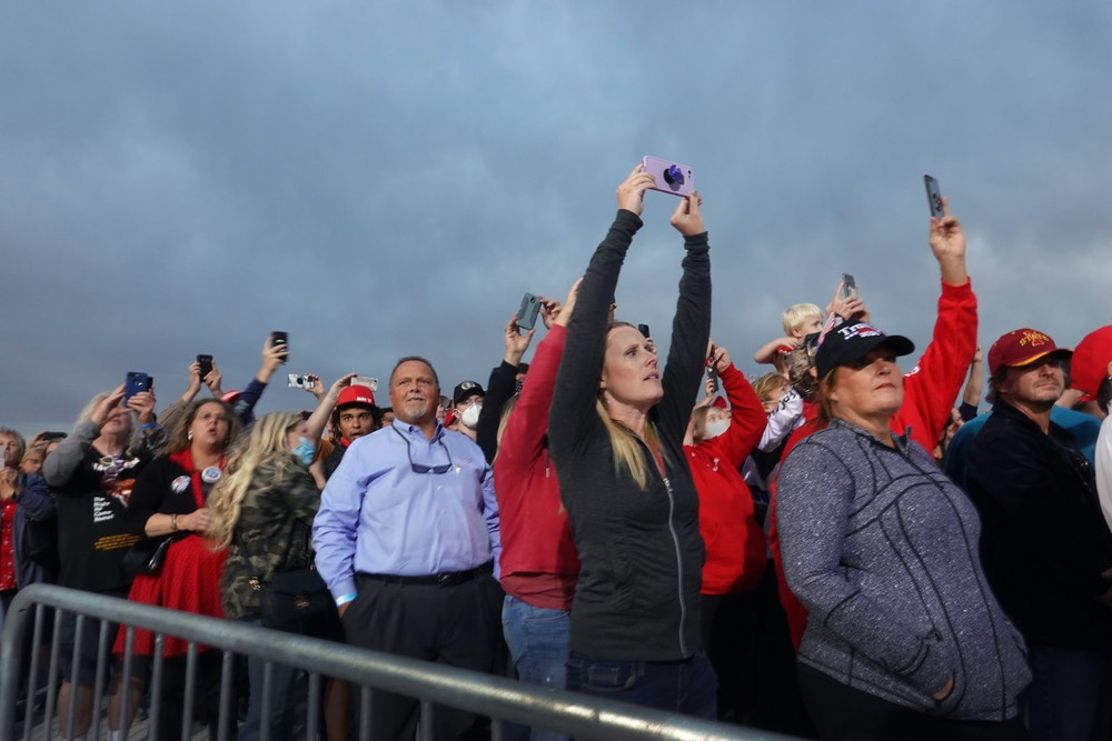 DES MOINES, IOWA - OCTOBER 14: Supporters take pictures as President Donald Trump arrives for a rally at the Des Moines International Airport on October 14, 2020 in Des Moines, Iowa. According to a recent poll Trump leads former Vice President Joe Biden by 6 points in the state.    (Photo by Scott Olson/Getty Images)
