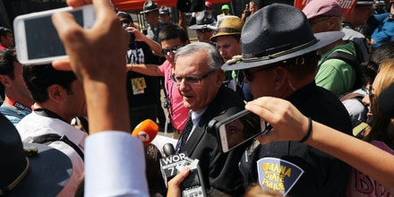 CLEVELAND, OH - JULY 19:  Maricopa County Sheriff Joe Arpaio is surrounded by protesters and members of the media at the the site of the Republican National Convention (RNC) in downtown Cleveland on the second day of the convention on July 19, 2016 in Cleveland, Ohio. Many people have stayed away from downtown due to road closures and the fear of violence. An estimated 50,000 people are expected in Cleveland, including hundreds of protesters and members of the media. The four-day Republican National Convention kicked off on July 18.  (Photo by Spencer Platt/Getty Images)