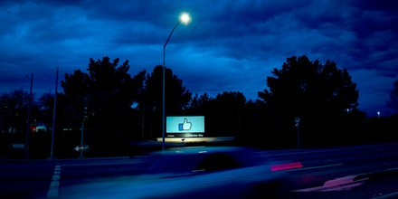 A car passes by Facebook's corporate headquarters location in Menlo Park, California, on March 21, 2018.