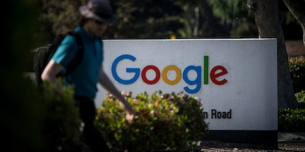 A pedestrian walks past signage at Google Inc. headquarters in Mountain View, California, U.S., on Wednesday, April 25, 2018. Alphabet Inc. is pushing efforts to roll back the most comprehensive biometric privacy law in the U.S., even as the company and its peers face heightened scrutiny after the unauthorized sharing of data at Facebook Inc. Photographer: David Paul Morris/Bloomberg via Getty Images
