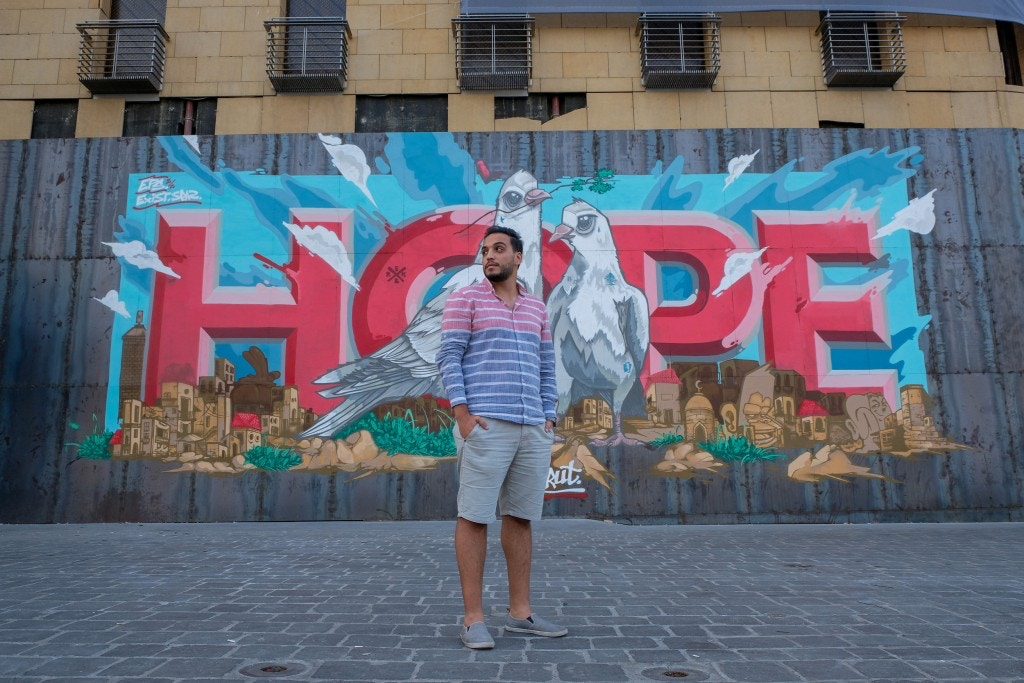 Ahmad Tahan posing in front of a recent graffiti of 'HOPE': An October Revolution activist and filmmaker who was heavily involved in last year's protests and has been volunteering on the ground every day since the August 4 blast.