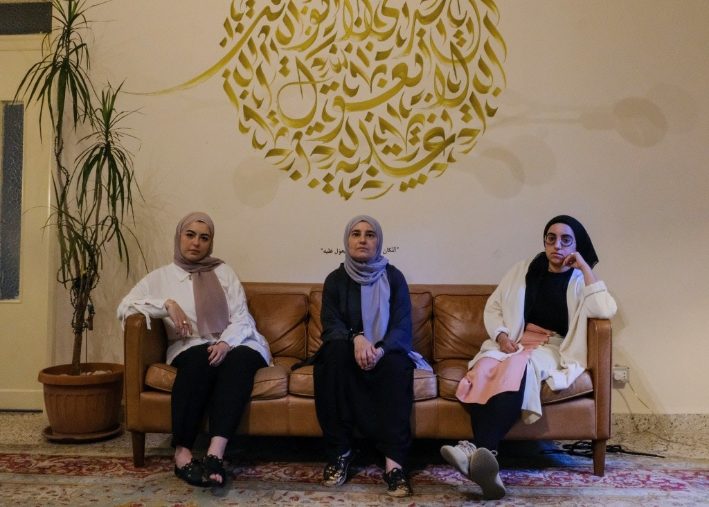 Aya Zantout, Jude Chehab and Hiba Khoda posing on the sofa under their meaningful symbol inside Al Makan center.