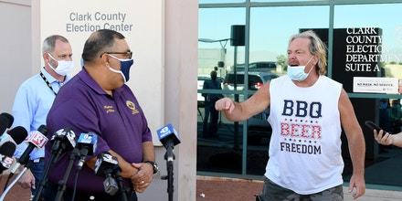 NORTH LAS VEGAS, NEVADA - NOVEMBER 04:  A protester interrupts a news conference by Clark County Registrar Joe Gloria (L) discussing ballot counting at the Clark County Election Department on November 4, 2020 in North Las Vegas, Nevada. Donald Trump and Joe Biden are in a tight race in the battleground state after yesterday's election.  (Photo by Ethan Miller/Getty Images)