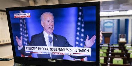 U.S. President-elect Joe Biden is displayed on a television monitor in the James S. Brady Press Briefing Room at the White House while speaking during an election event in Washington, D.C., U.S., on Saturday, Nov. 7, 2020. Biden defeated Donald Trump to become the 46th U.S. president, unseating the incumbent with a pledge to unify and mend a nation reeling from a worsening pandemic, faltering economy and deep political divisions. Photographer: Chris Kleponis/Sipa/Bloomberg
