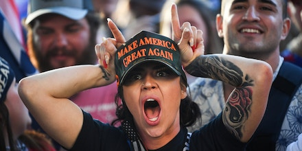 UNITED STATES - NOVEMBER 14: A Trump supporter calls counter-protesters devils outside of the U.S. Supreme Court during the Million MAGA March in Washington on Saturday, Nov. 14, 2020. (Photo by Caroline Brehman/CQ Roll Call)