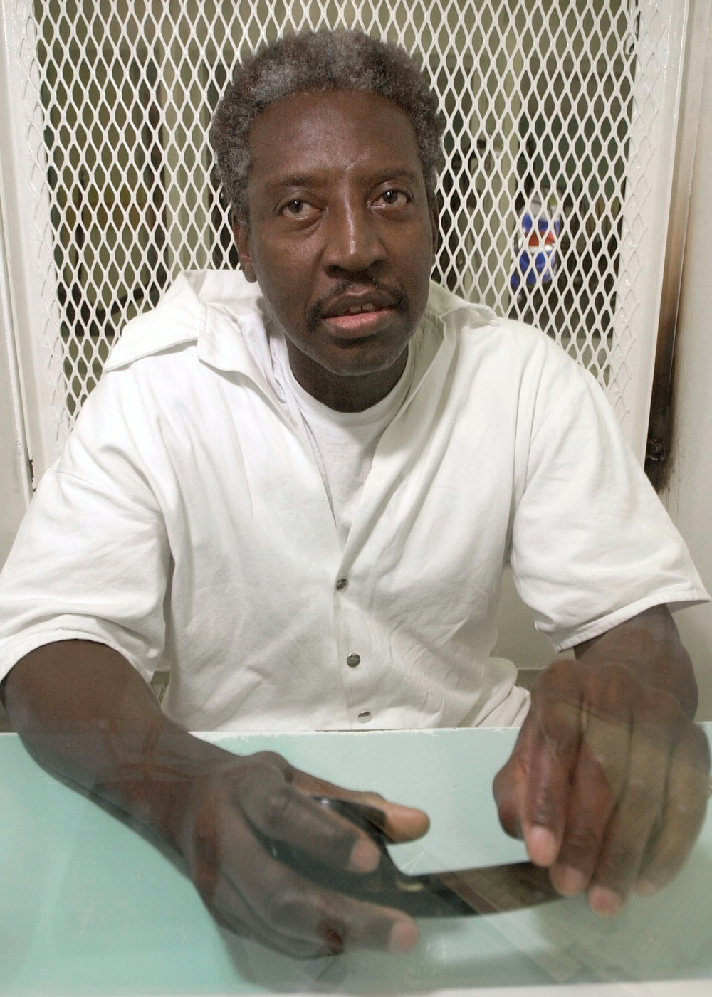 **FILE** Death row inmate Thomas Miller-El, sits in a visitation cell at the Texas Department of Criminal Justice's the Polunsky Unit in Livingston, Texas, in a  Feb. 20, 2002 photo.  Miller- El, who was on death row for nearly 20 years until the Supreme Court overturned his verdict because of racial discrimination during jury selection has pleaded guilty, Wednesday, March 19, 2008 to the killing for which he was originally sentenced to die. (AP Photo/Brett Coomer, File)