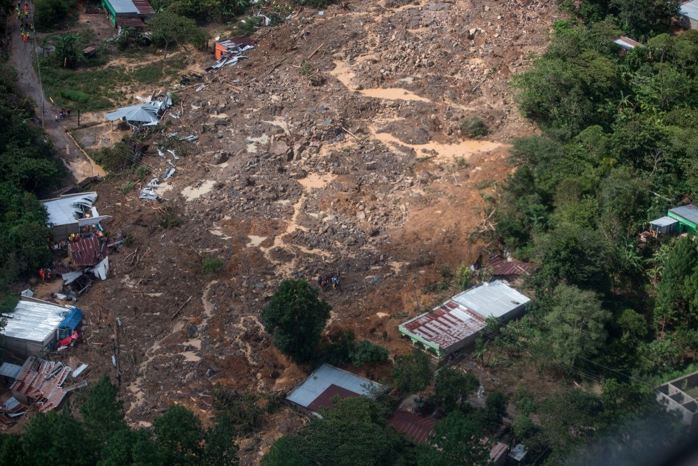An aerial view of the massive, rain-fueled landslide in the village of Queja, in Guatemala, Saturday, Nov. 7, 2020, in the aftermath of Tropical Storm Eta. (Esteban Biba/Pool Photo via AP)
