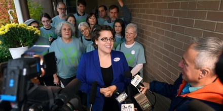 Dana Balter, candidate for the House of Representatives in New York's 24th Congressional District, speaks with the media after casting her vote in Syracuse, N.Y., Tuesday, Nov. 6, 2018. (AP Photo/Adrian Kraus)