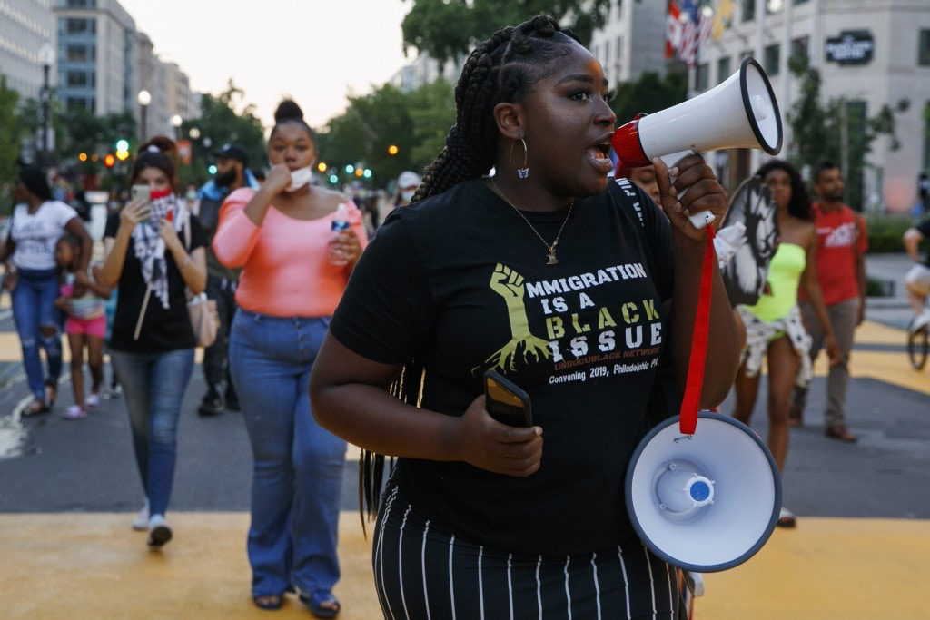 Joella Roberts, 22, of Washington, center, who is a recipient of the Deferred Action for Childhood Arrivals, or DACA, leads a protest near the White House, on June 12, 2020, in Washington, over the death of George Floyd.
