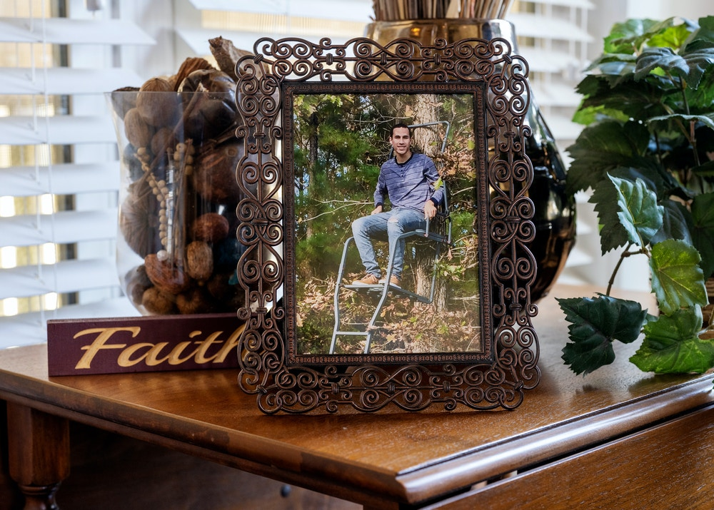 A framed photograph of Cameron Davis is displayed in Michelle Durden's living room in Jacksonville, North Carolina, on November 16, 2020.