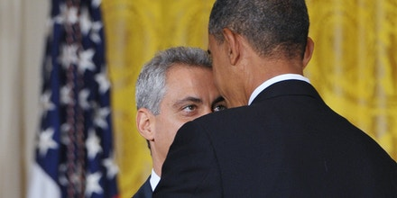 Outgoing White House Chief of Staff Rahm Emanuel (L) hugs US President Barack Obama after announcing Emanuel's departure on October 1, 2010 in Washington, DC.