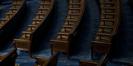 Empty Republican seats are seen in the House Chamber before a ceremony for the opening of the 116th Congress in Washington, D.C., U.S., on Thursday, Jan. 3, 2019. Nancy Pelosi is all but certain to become House speaker on Thursday as the new Congress is sworn in and Democrats claim control of the chamber, setting up two years of confrontation and possible compromise with President Donald Trump. Photographer: Andrew Harrer/Bloomberg via Getty Images