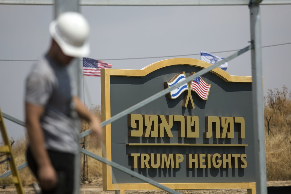 GOLAN HEIGHTS, ISRAEL - JUNE 17: An Israeli man works near a sign for a new settlement named after US President Donald Trump on June 17, 2019 in Golan Heights, Israel. The Israeli goverment named the new settlement 'Trump Heights' to honor Trump's decision to recognise sovereignty over the Golan Heights. (Photo by Amir Levy/Getty Images)