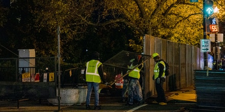 Workers erect barriers in an expanded permitter around the White House the night before the presidential election on November 2, 2020 in Washington, DC.