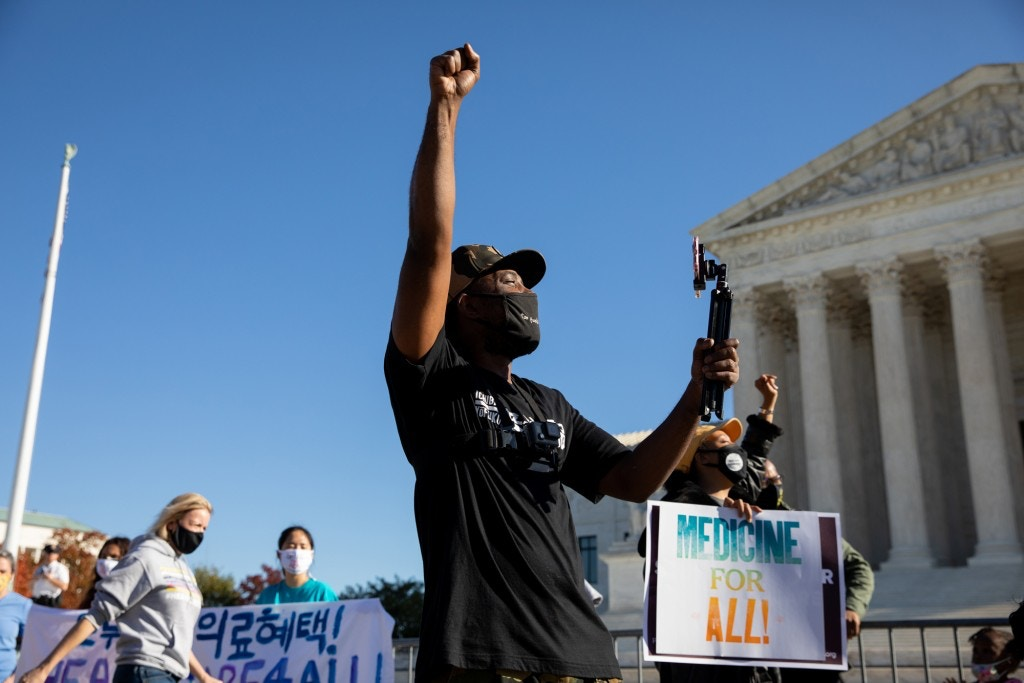 A demonstrator raises his fist outside of the U.S. Supreme Court in Washington, D.C., U.S., on Nov. 10, 2020.