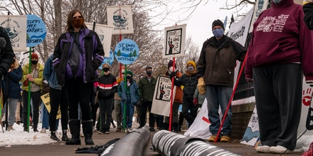 ST PAUL, MN - NOVEMBER 14: People protest against the Enbridge Energy Line 3 oil pipeline project outside the Governor's Mansion on November 14, 2020 in St Paul, Minnesota. The project took a step forward this week after receiving permitting approval from the Minnesota Pollution Control Agency. (Photo by Stephen Maturen/Getty Images)
