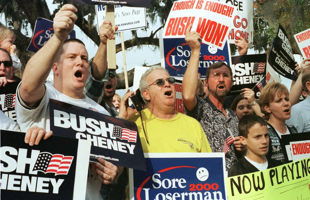 383075 03: Crowds of George W. Bush supporters celebrate the decision to stop the vote recount December 9, 2000 at the Leon County Public Library in Tallahassee. The case will be argued before the U.S. Supreme Court on Monday, December 11, 2000. (Photo by Robert King/Newsmakers)