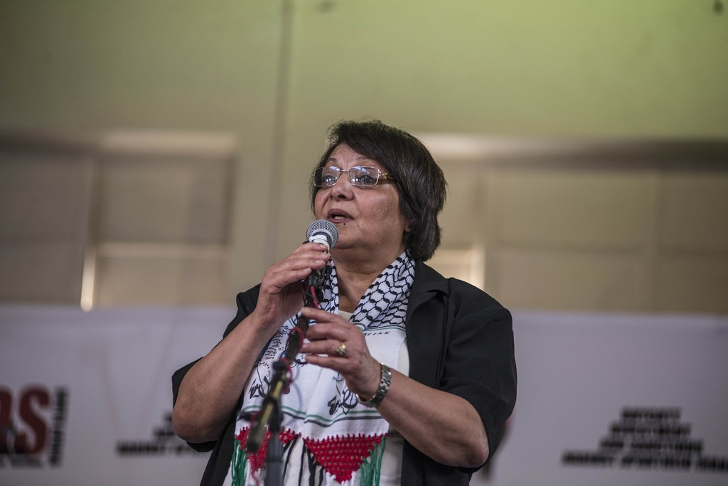 Palestinian activist Leila Khaled addresses the crowd at the DOCC Hall in Orlando East, Soweto, South Africa on February 15, 2015.