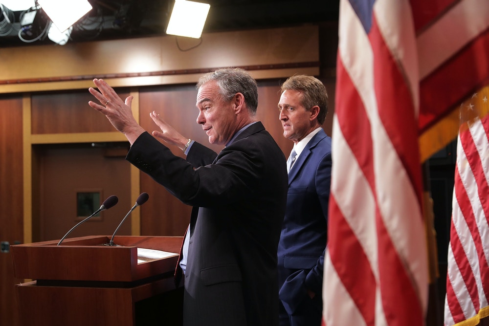 WASHINGTON, DC - MAY 25:  Sen. Tim Kaine (D-VA) (L) and Sen. Jeff Flake (R-AZ) talk about their introduction of a new Authorization for the Use of Military Force (AUMF) against the Islamic State of Iraq and Syria (ISIS), al-Qaeda and the Taliban during a news conference at the U.S. Capitol May 25, 2017 in Washington, DC. The new AUMF would repeal and replace Congress' 2001 and 2002 authorizations while expanding the list of terrorist organizations that the U.S. can take military action against.  (Photo by Chip Somodevilla/Getty Images)