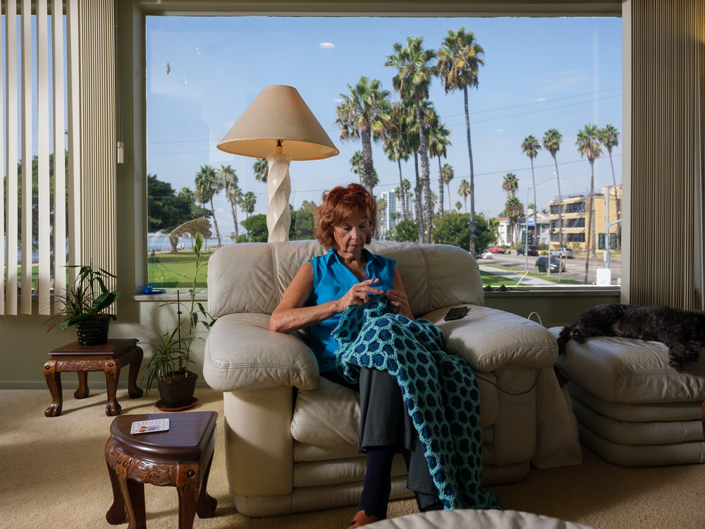 Jane Dorotik works on a blanket she is knitting while at her sister Bonnie's house in Long Beach on October 8, 2020.