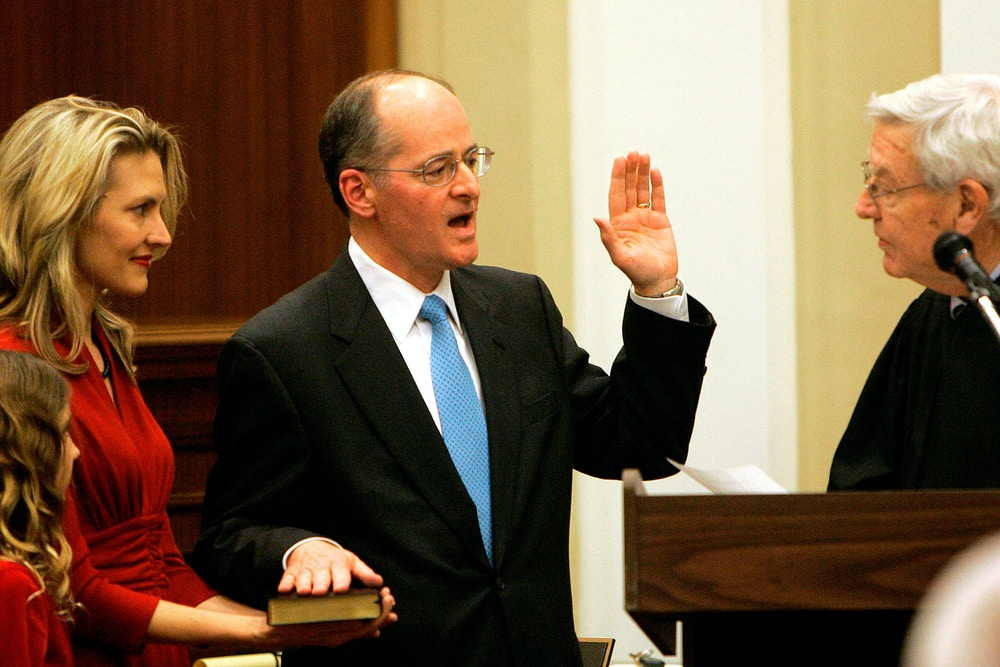Charles Canady, center, takes the oath of office as he is sworn in as Supreme Court Justice by Justice Charles Wells, right, duirng ceremonies, Wednesday, Dec. 3, 2008, in Tallahassee, Fla.  Looking on and holding the bible is Canady's wife Jennifer as daughters Julia, left center, and Anna look on.(AP Photo/Phil Coale)