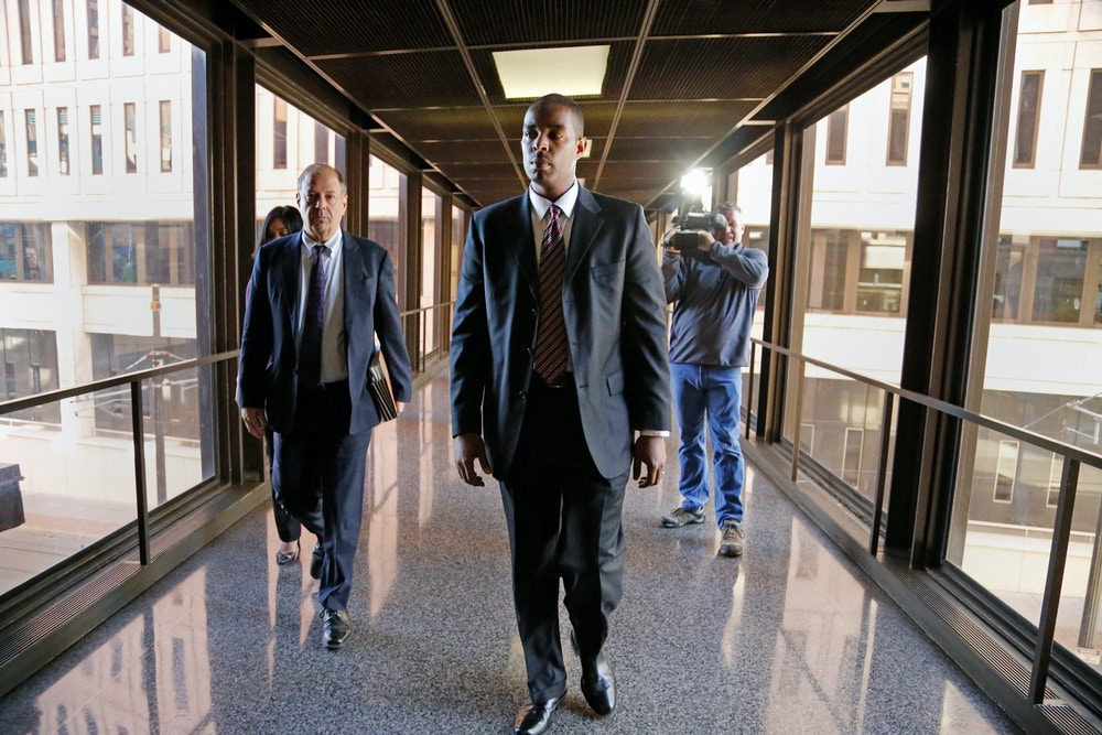 Former Minneapolis FBI agent Terry Albury, front, followed by his attorney Joshua Dratel walk out of the Federal Courthouse in St. Paul Thursday, Oct. 18, 2018 after Albury was sentenced to four years in prison for leaking classified defense documents to a reporter.  (Shari L. Gross/Star Tribune via AP)