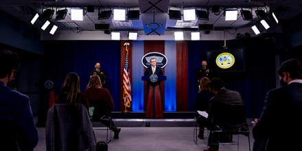 Secretary of the Army Ryan McCarthy, center, accompanied by Sergeant Major of the Army Michael A. Grinston, left, and Gen. James McConville, Chief of Staff of the Army, right, speaks at a briefing on an investigation into Fort Hood, Texas at the Pentagon, Tuesday, Dec. 8, 2020, in Washington. The Army says it has fired or suspended 14 officers and enlisted soldiers at Fort Hood, Texas, and ordered policy changes to address chronic leadership failures at the base that contributed to a widespread pattern of violence including murder, sexual assaults and harassment. (AP Photo/Andrew Harnik)