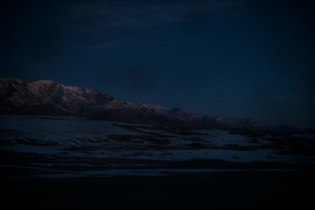 Mountains covered in this winter's first snow in Wardak province, as seen from the Kabul-Kandahar Highway where it passes through Sayedabad district, at dawn.