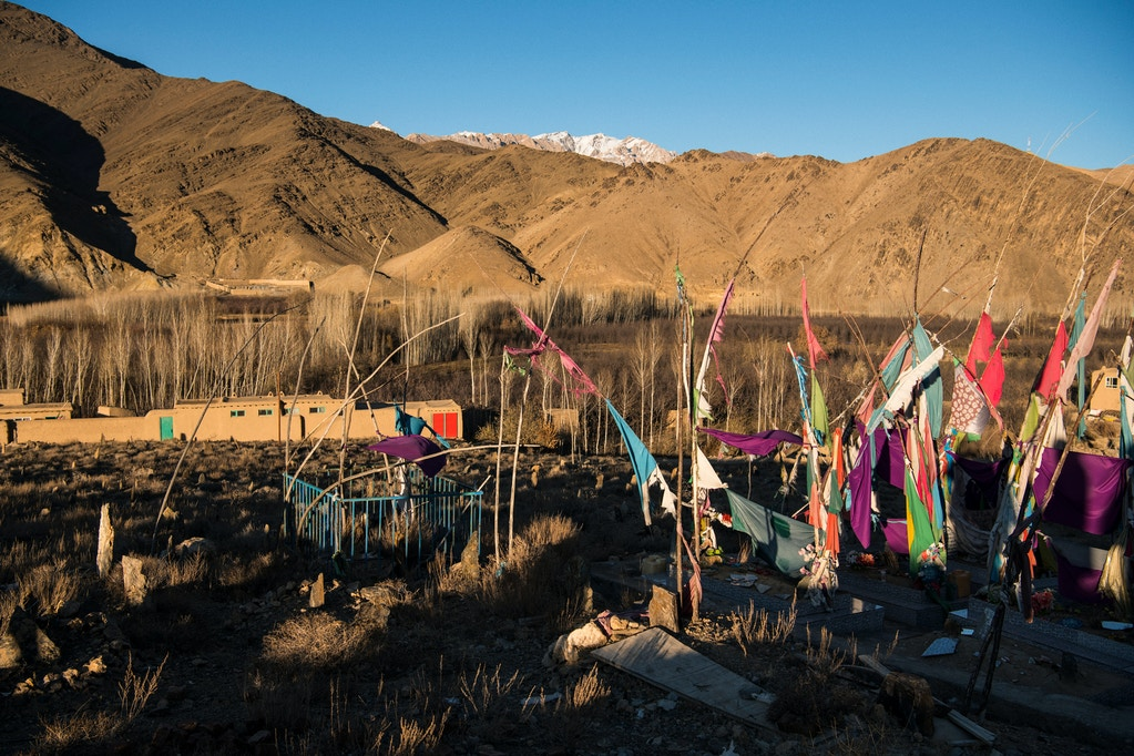 Homemade flags mark the graves of a mother and three children, ages 6, 8, and 15, who were killed in a 01 night raid in the village of Sher Toghi, Daymirdad District, on the night of March 2 and the morning of March 3, 2019. The 15-year-old was shot when he ran outside to look for help after a bomb hit the family home. Relatives found the bodies of the mother and daughters beneath the ruins of their house the next morning. It isn't known whether they succumbed to injuries from the air strikes or the freezing temperatures overnight.