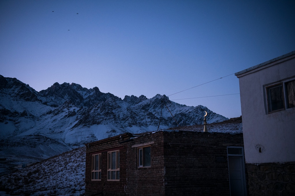 A crescent moon lit by the rising sun above a mosque in the village of Araban in Wardak's Chak District. Mosques and Islamic schools, known as madrassas, were regularly targeted by the CIA-led 01 strike force unit throughout Wardak in late 2018 and 2019, killing 33 religious students, according to The Intercept's investigation.