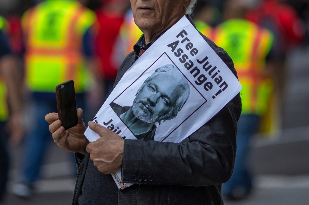 LOS ANGELES, CA - MAY 01: A man holds a sign calling for the release of Julian Assange as people march and rally on May Day, also known as International Workers Day, on May 1, 2019 in Los Angeles, California. People are participating in multiple May Day marches and rallies around Los Angeles, calling for support of labor and immigrant concerns such as wage improvement, immigration reform and a citizenship question in the upcoming national census.  (Photo by David McNew/Getty Images)
