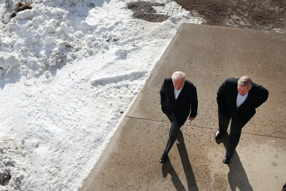 "ALGONA, IOWA - DECEMBER 02:  Democratic presidential candidate, former Vice President Joe Biden (L) arrives at a campaign stop with former U.S. Agriculture Secretary and former Iowa Gov. Tom Vilsack on December 2, 2019 in Algona, Iowa. The stop was part of Biden's 650-mile ""No Malarkey"" campaign bus trip through rural Iowa. The 2020 Iowa Democratic caucuses will take place on February 3, 2020, making it the first nominating contest for the Democratic Party in choosing their presidential candidate to face Donald Trump in the 2020 election. (Photo by Scott Olson/Getty Images)"