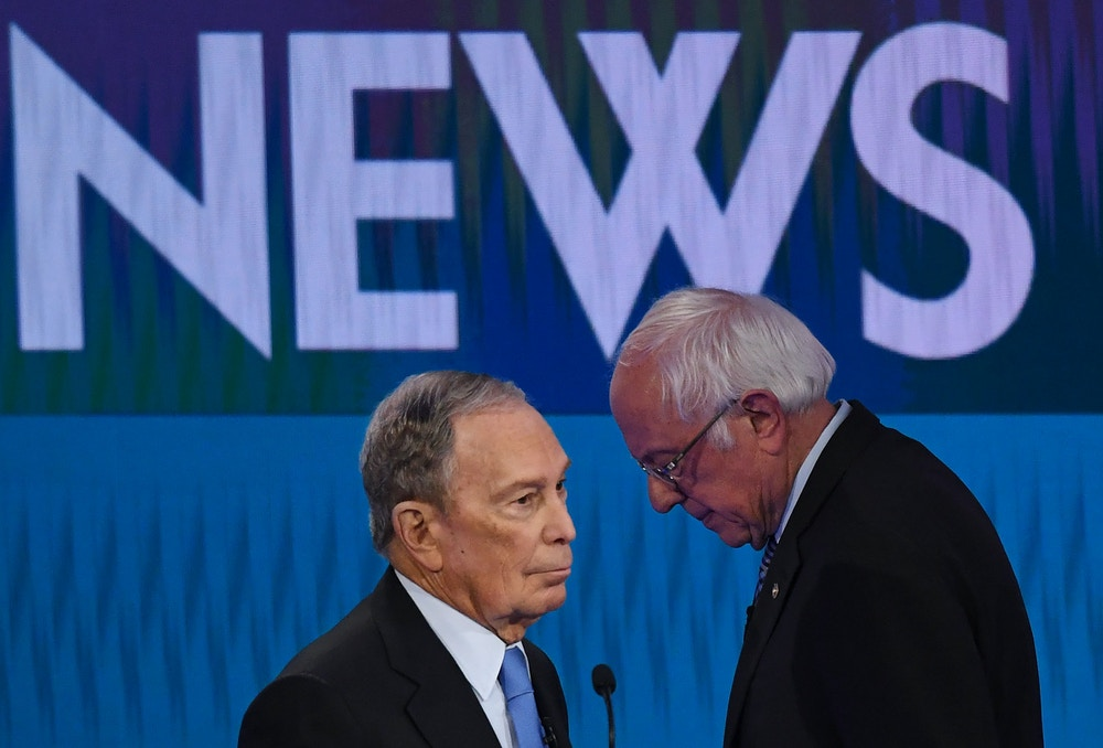 Democratic presidential hopefuls Former New York Mayor Mike Bloomberg (L) and Vermont Senator Bernie Sanders (R) speak during a break in the ninth Democratic primary debate of the 2020 presidential campaign season co-hosted by NBC News, MSNBC, Noticias Telemundo and The Nevada Independent at the Paris Theater in Las Vegas, Nevada, on February 19, 2020. (Photo by Mark RALSTON / AFP) (Photo by MARK RALSTON/AFP via Getty Images)