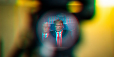 President Donald J. Trump, reflected in a television camera, speaks with his coronavirus task force in response to the COVID-19 coronavirus pandemic during a briefing in the James S. Brady Press Briefing Room at the White House on March 18, 2020 in Washington, DC.