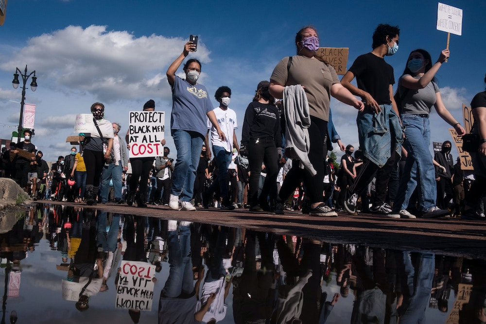 DETROIT, MI - MAY 29: Protesters gather to protest the recent killing of George Floyd on May 29, 2020 in Detroit, Michigan. Demonstrations are being held across the US after George Floyd died in police custody on May 25th. (Photo by Matthew Hatcher/Getty Images)
