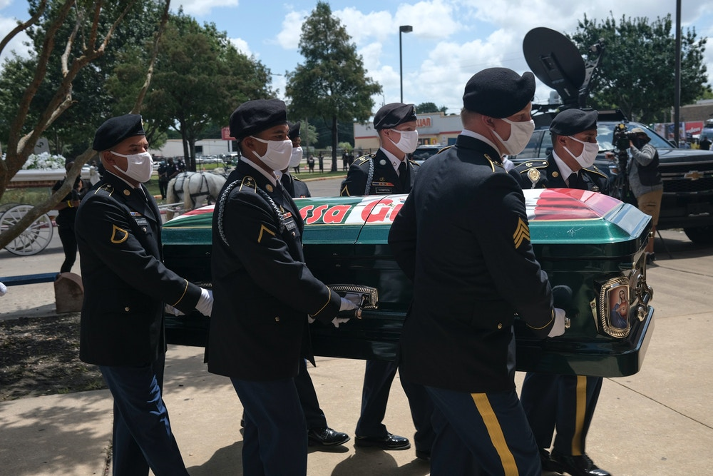 HOUSTON, TX - AUGUST 14: Military personnel carry the casket of murdered U.S. Army Private First Class Vanessa Guillen to Cesar Chavez High School for her memorial service on August 14, 2020 in Houston, Texas. Guillen, a 20-year-old U.S. Army Specialist, was found dead on June 30 after she had been reportedly missing since April 22. Guillen was allegedly killed by fellow soldier Aaron David Robinson inside the Fort Hood military base.  (Photo by Go Nakamura/Getty Images)