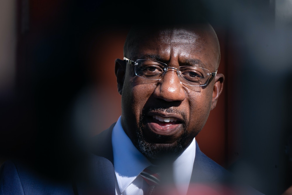 Raphael Warnock, U.S. Democratic Senate candidate, speaks during a news conference in Atlanta, Georgia, U.S., on Thursday, Nov. 12, 2020. Republican willingness to go along with President Donald Trumps extended fight over the presidential election may have as much to do with the Georgia runoffs that will determine control of the Senate as with resolving the presidents grievances over the vote count. Photographer: Elijah Nouvelage/Bloomberg via Getty Images